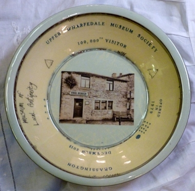 The 100,000th ticket sold for entry commemorative plate
